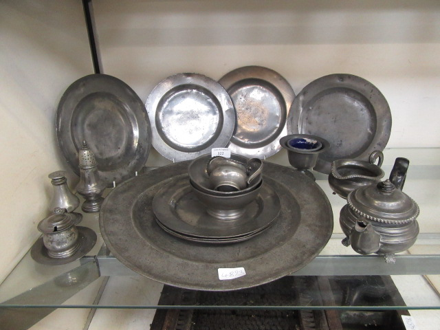 A collection of pewter plates, tea set etc.