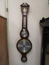 A reproduction mahogany banjo barometer by Sewills of Liverpool