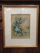 A framed and glazed watercolour of ivy and flowers signed H.E.