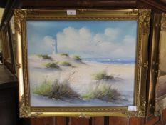 A gilt framed oil on board of beach scene signed Loomis Dean