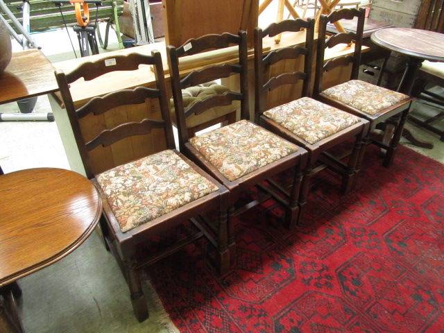 A set of four early 20th century oak framed dining chairs