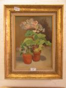 A framed oil on canvas of still life signed Aziza