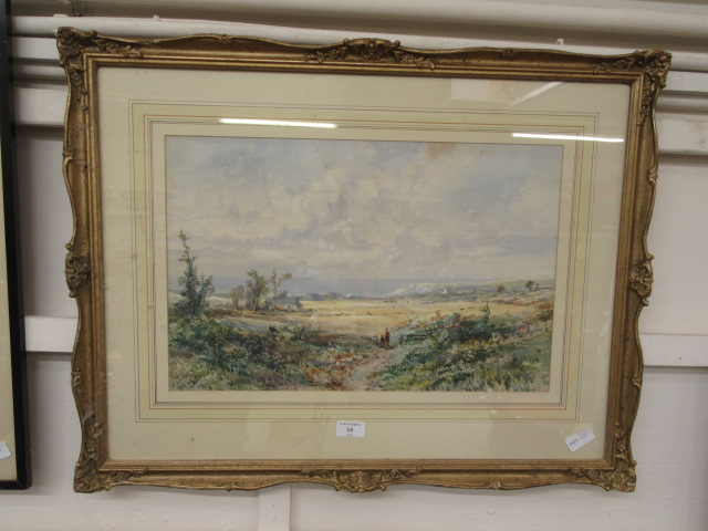 A framed and glazed watercolour of countryside scene signed E.