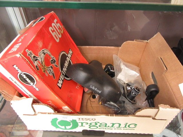 A small box containing an assortment of bicycle parts to include brakes, gears etc.