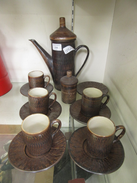 A part mid-20th century stoneware coffee set by Presto Potteries comprising of five cups and six