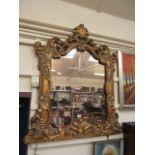 A modern ornate framed over mantle mirror