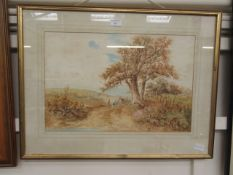 A framed and glazed watercolour of country lane scene signed J.
