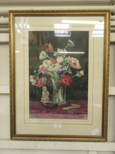 A framed and glazed watercolour of still life signed Eynon