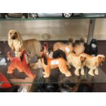 A selection of molded and ceramic dogs