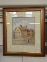 A framed and glazed watercolour of dilapidated house scene signed W.H.