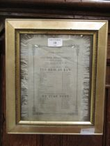 A framed and glazed silk programme for the amateur theatricals at Jesus college