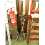 A selection of long handled garden tools
