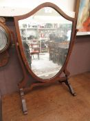 An early 20th century shield toilet mirror