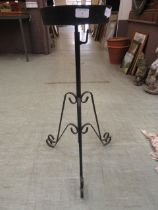 A black painted metal adjustable plant stand