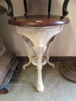 A 19th century cast iron white painted pub table with mahogany top