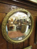 A gilt framed convex mirror
