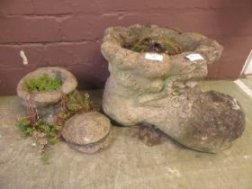 Two composite stone planters in the form of boots
