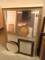 An ornate gilt framed bevel glass mirror along with two other mirrors