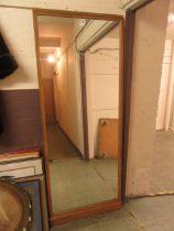 An early 20th century oak framed floor standing mirror