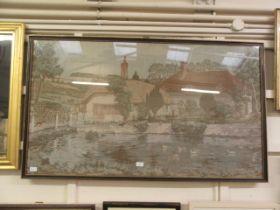 A framed and glazed embroidery of farmhouse scene