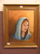 A gilt framed oil on canvas of eastern lady's head signed Irenie Herring