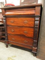A late 19th century walnut chest of four long drawers
