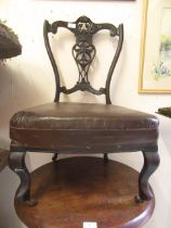 An Edwardian mahogany bedroom chair having carved and pierced top rail on cabriole legs