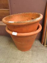 Two terracotta plant pots CONDITION REPORT: Circumferences are as follows: Bottom: