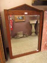 An early 20th century oak framed bevel glass mirror
