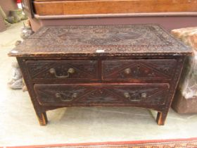 A 19th century carved pine low level chest of two short over one long drawer