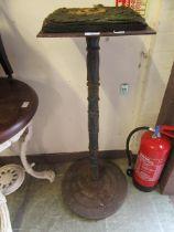 A 19th century cast iron tall pub table base