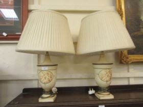 A pair of modern table lamps with classical urn design columns