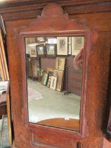 A Georgian style pine framed fretwork mirror