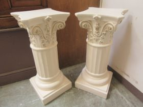 A pair of cream painted Corinthian column pedestals