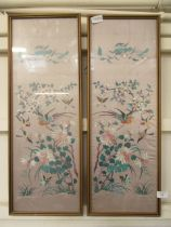 A pair of framed and glazed oriental silk embroideries