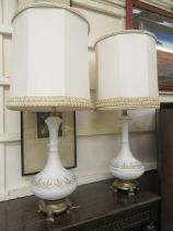 A pair of American white glass and parcel gilt table lamps
