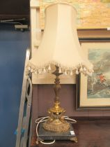 A gilt metal columned classical style table lamp on marble base