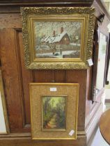 A gilt framed oil on board of snowy cottage scene signed Anthony Buckley along with one other