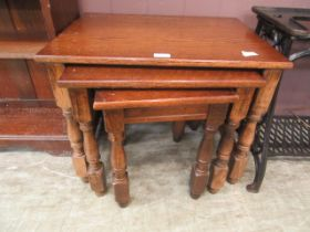 A nest of three reproduction oak and beech tables