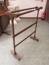 An early 19th century mahogany towel rail (A/F)
