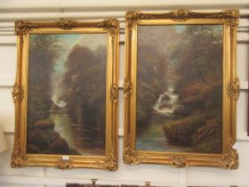 A pair of gilt framed oil on canvases of river scenes one signed W.