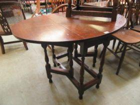 A 19th century oak oval gate legged table