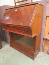 An early 20th century Globe Werlicke bureau bookcase having a fall to top door with glazed section