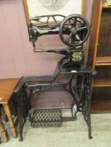 An early 20th century Singer manual leather sewing machine model no.