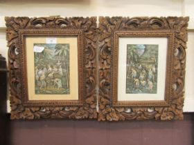 A pair of framed and glazed oriental prints of farmers in carved frames