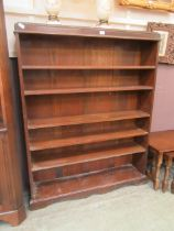 An early 20th century oak open bookcase with adjustable shelving