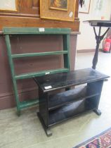 A set of green painted wall hanging shelves along with a black painted occasional table