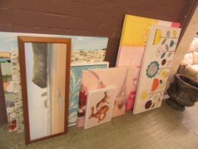 A quantity of modern stretched canvases together with a framed and glazed print of beach scene
