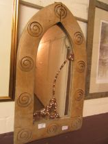 A modern wooden arch-topped wall mirror