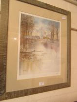 A framed and glazed signed print of house by lake scene